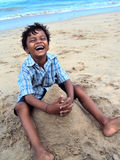 Beach fun. Boy making a home in beach Stock Photography