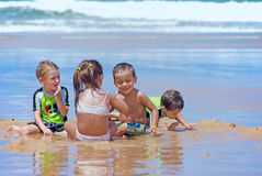 Beach Fun. Children play under a hot sun rays at a summer day Royalty Free Stock Photography