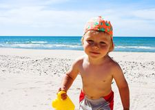 Beach fun. Young boy playing at the beach Royalty Free Stock Photo