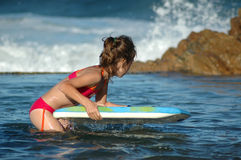 Beach Fun. Girl on a boogie board stock photos