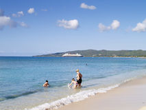 Beach Fun. A family enjoying their holidays on the beach at Fredriksted, St. Croix, in US Virgin Islands Stock Image