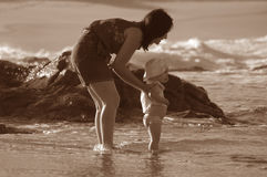 Beach Fun. Sepia image of mother and daughter at the beach Stock Photo