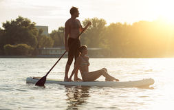 Beach fun couple on stand up paddle board SUP06 Royalty Free Stock Photography