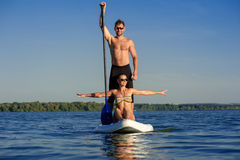 Beach fun couple on stand up paddle board SUP04 Royalty Free Stock Photography