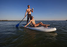 Beach fun couple on stand up paddleboard SUP01 Royalty Free Stock Photo