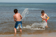 Beach fun - Enjoy on waves Stock Image