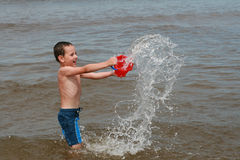 Beach fun - Enjoy on waves Royalty Free Stock Photography