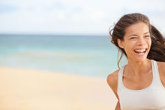 Beach fun - running woman closeup with copy space. Beach fun - happy running woman closeup with copy space. Smiling joyful elated girl jogging and laughing while Royalty Free Stock Photo