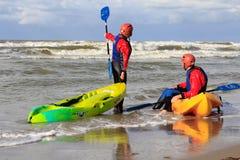 Beach fun on sit on top kayaks Royalty Free Stock Photos