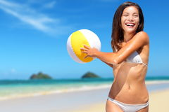 Beach fun summer vacation woman playing with ball Royalty Free Stock Photos