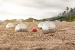 Beach. A game of Bocha. Brilliant silver balls for a bocha on the sand. royalty free stock images