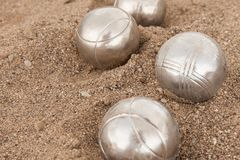 Brilliant silver balls for a bocha on the sand. stock images