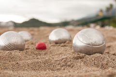 Brilliant silver balls for a bocha on the sand. Beach. A game of Bocha. Brilliant silver balls for a bocha on the sand royalty free stock photo