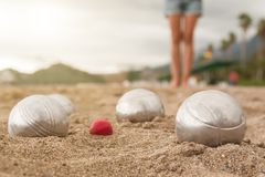 Brilliant silver balls for a bocha on the sand royalty free stock images