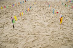 Beach games. Flags decorating the beach and creating lanes for fun fair games Stock Image