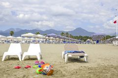 Beach with games for children in the foreground. In the background the Apuan Alps, Tuscany, Italy stock photography