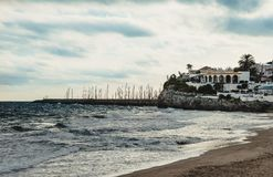 The beach of Garraf. Is located inside a bay. Catalonia, Spain Stock Image