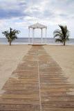 Beach Gazebo. Path to the undecorated beach gazebo for weddings royalty free stock photo