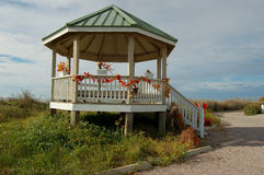 Beach Gazebo Holden Beach NC. A typical beach gazebo is decorated for Halloween. These small pavilions provide shade while enjoying the view of the beach royalty free stock photos
