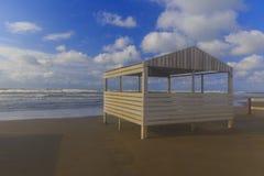 Beach gazebo overlooking the stormy sea stock photo