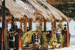 Beach gazebo with palm leaves. With local decoration Bali Royalty Free Stock Photography