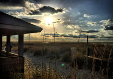Beach Gazebo. The sun setting behind a beach gazebo, at the south end of Wrightsville Beach, NC royalty free stock images