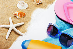 Beach gear lie on the sand Stock Image