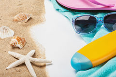 Beach gear lie on the sand with shells Royalty Free Stock Photography