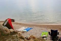 Beach gear on pebble shore Stock Image