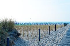 Beach on the German Baltic Sea with beach chair and holiday feeling with sand.  royalty free stock photography