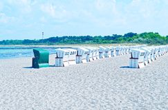 Beach on the German Baltic Sea with beach chair and holiday feeling with sand.  Stock Image