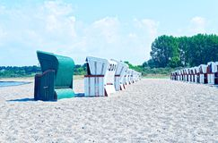 Beach on the German Baltic Sea with beach chair and holiday feeling with sand.  stock photo