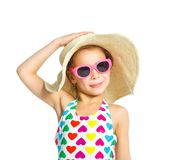 Beach girl. Portrait of young summer girl smiling in multi-colored swimsuit, glassis and beach hat. Isolated on white background Royalty Free Stock Images