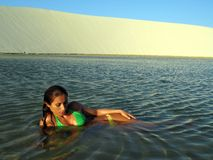 Beach girl. Girl in the lagoon between dunes - National Park of the Lencois Maranhenses - Brazil royalty free stock photography