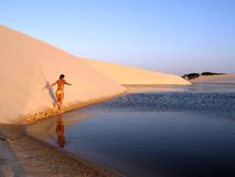 Beach girl. Walking girl in the dune - National Park of the Lençois Maranhenses - Brazil Stock Photo