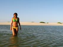 Beach girl. Walking girl in the lagoon - National Park of the Lençois Maranhenses - Brazil Stock Image