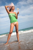 Beach girl. Woman with hat on the beach with lolli stock photos