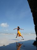 Beach girl. Girl jumping in the beach of the Atalaia north of Brazil Royalty Free Stock Photography