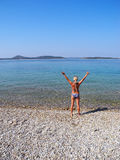 On the beach. The girl on the beautiful beach of Vodice royalty free stock photo