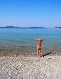 On the beach. The girl on the beautiful beach of Vodice stock photography