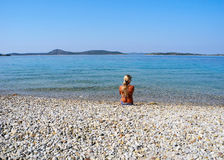 On the beach. The girl on the beautiful beach of Vodice royalty free stock image