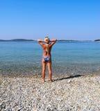 On the beach. The girl on the beautiful beach of Vodice stock photos
