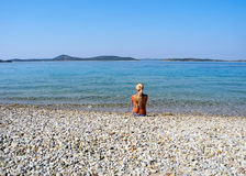 On the beach. The girl on the beautiful beach of Vodice stock image