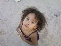 Beach girl. Curly haired beautiful baby at the beach Royalty Free Stock Photography