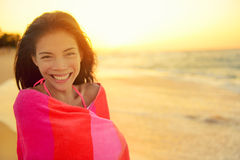 Beach girl happy laughing smiling wrapped in towel Royalty Free Stock Photography