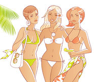 Beach girls. Three tanned women on the beach. Bodies and accessories are separate Royalty Free Stock Photo