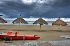 At the beach in Giulianova before the thunderstorm. Empty  beach  and stormy weather  at the sea in Giulianova just before the thunderstorm stock photos