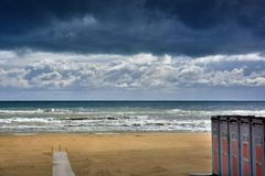 At the beach in Giulianova before the thunderstorm. Empty  beach  and stormy weather  at the sea in Giulianova just before the thunderstorm stock photography