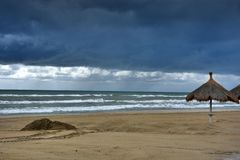 At the beach in Giulianova before the thunderstorm. Empty  beach  and stormy weather  at the sea in Giulianova just before the thunderstorm royalty free stock image
