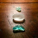 Beach glass on antique table. Royalty Free Stock Image